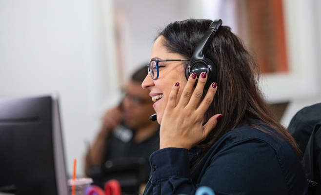 a smiling woman on the phone