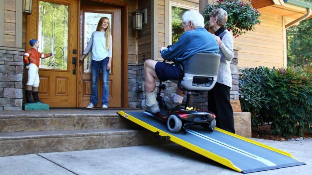 a man going up a wheelchair ramp